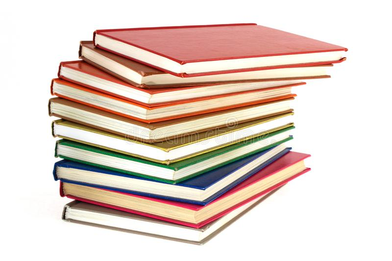 Pile of multi-colored books on a white background stock photo