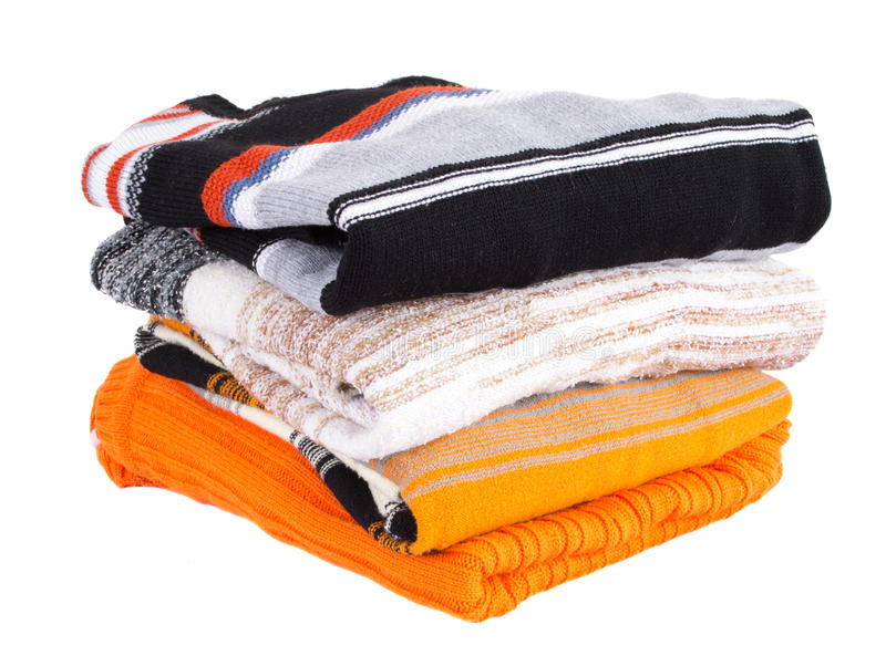 Pile of multi-colored sweaters stock photo