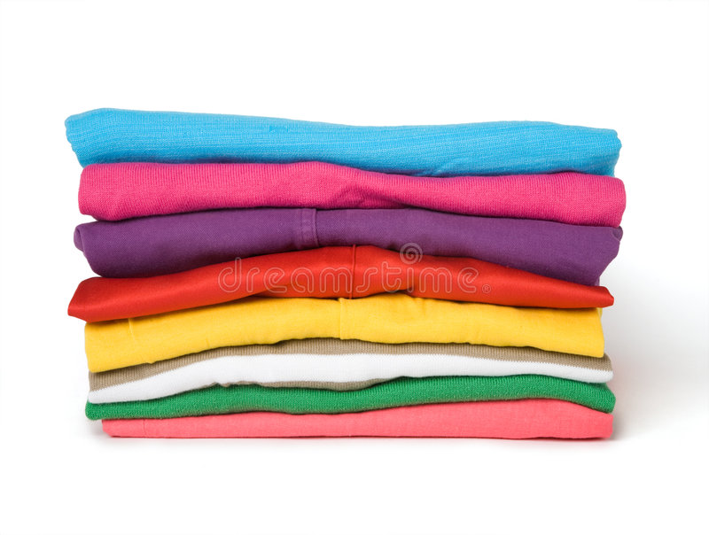 Pile of multi-coloured clothes. The combined multi-coloured clothes on a white background royalty free stock image