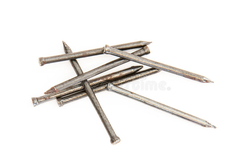 Pile of nails on white background royalty free stock photos