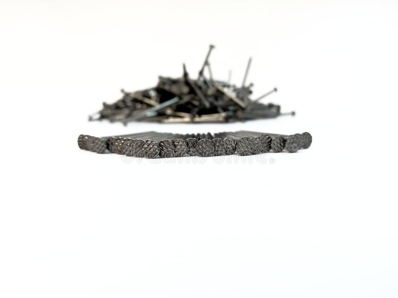 Pile of nails on white background royalty free stock image