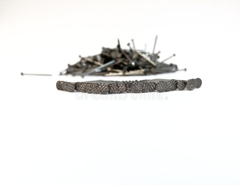 Pile of nails on white background stock image