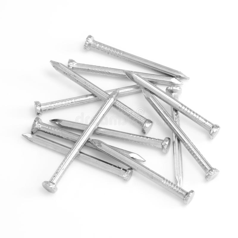 Pile of nails on a white background royalty free stock images