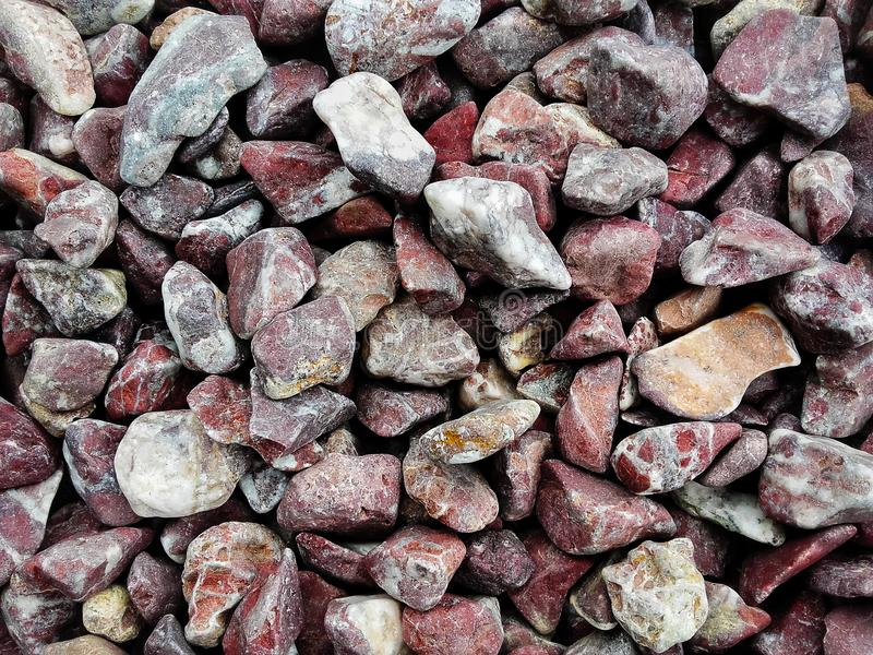 Pile  of natural  brown grunge   stones used to decorate the garden or parts of the house indoor or outdoor stock photo