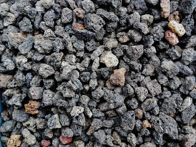 Natural  porous volcanic rock    stones used to decorate the garden or parts of the house indoor or outdoor. Pile  of natural  porous volcanic rock    stones royalty free stock photography