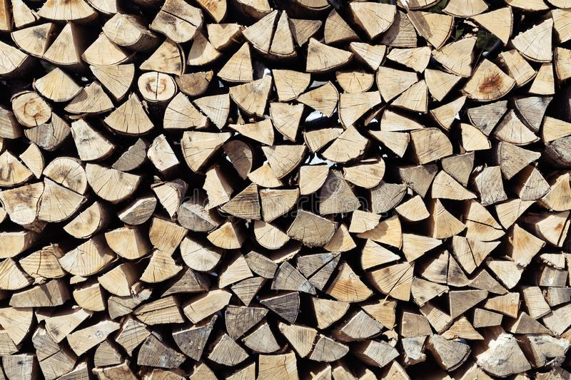Pile of neatly stacked cut and split spruce tree firewood viewed from front stock photos