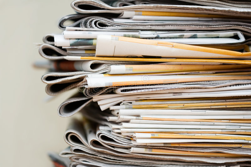 Pile of newspapers. Big pile of newspapers, focus in front royalty free stock photography