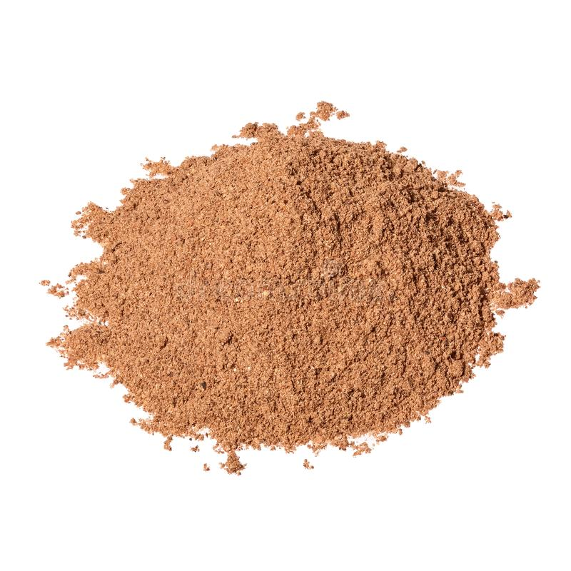 Pile of Nutmeg powder isolated on white background. Used as a spice in many sweet dishes. Pile of Nutmeg powder isolated on white background. Used as a spice in royalty free stock photo