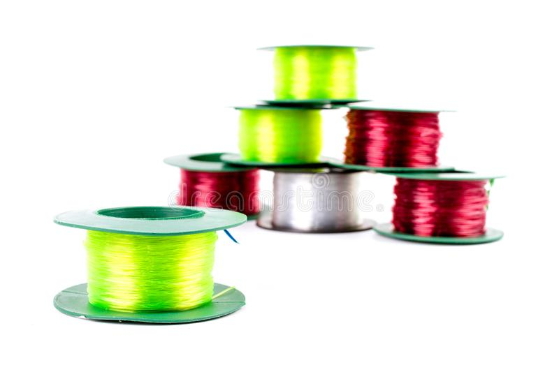 Pile of Nylon Three Colors. Pile of Nylon Three Colors : Red light, Green light and Clear in plastic roll for fishing or construction work isolated on white stock photos