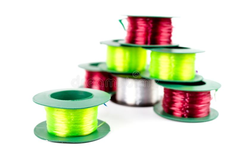 Pile of Nylon Three Colors. Pile of Nylon Three Colors : Red light, Green light and Clear in plastic roll for fishing or construction work isolated on white royalty free stock photography