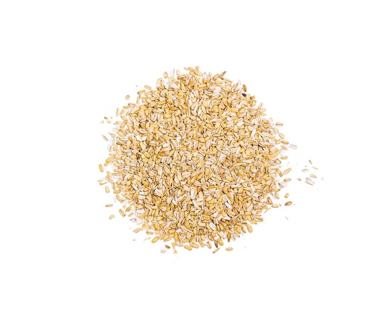 Pile of oat flakes, heap of uncooked ripe oat ears grains, oatmeal, isolated on white background, top view, healthy food stock photo
