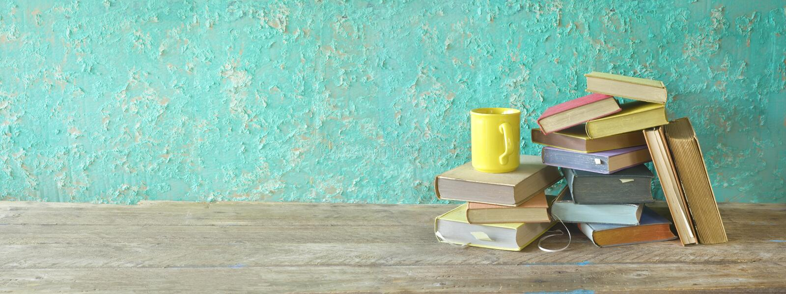 Pile of old books and a cup of coffee, panorama, reading education. Literature concept good copy space royalty free stock photos