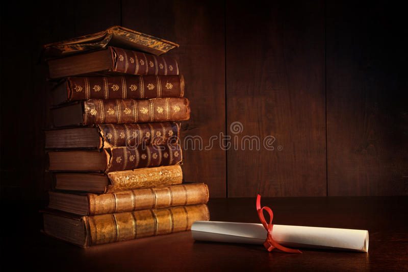 Download Pile of old books on desk stock image. Image of classroom - 26489029