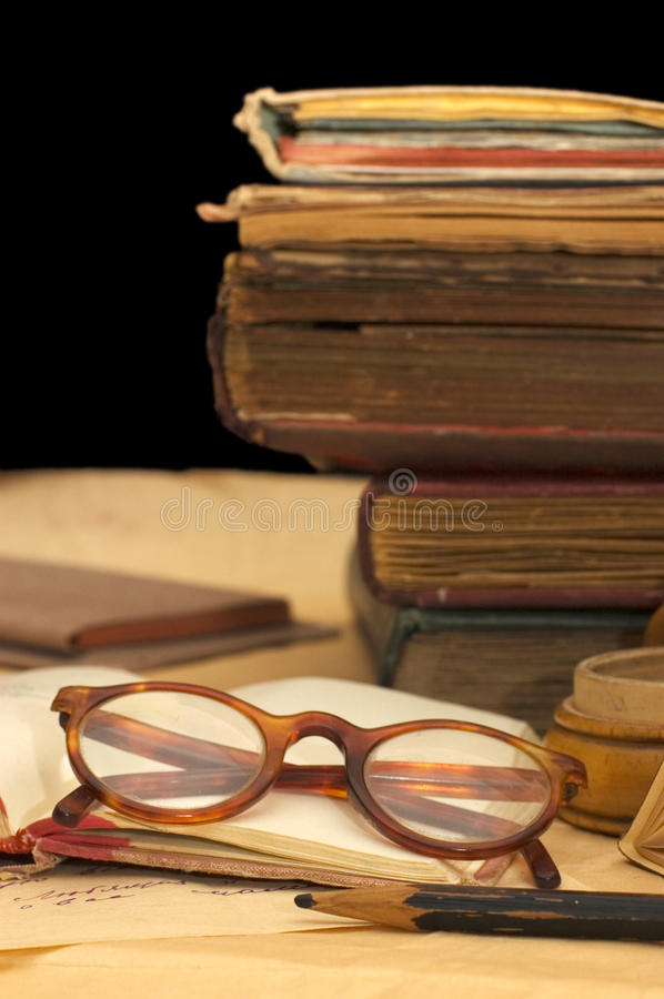 Pile of old books and different things royalty free stock photo