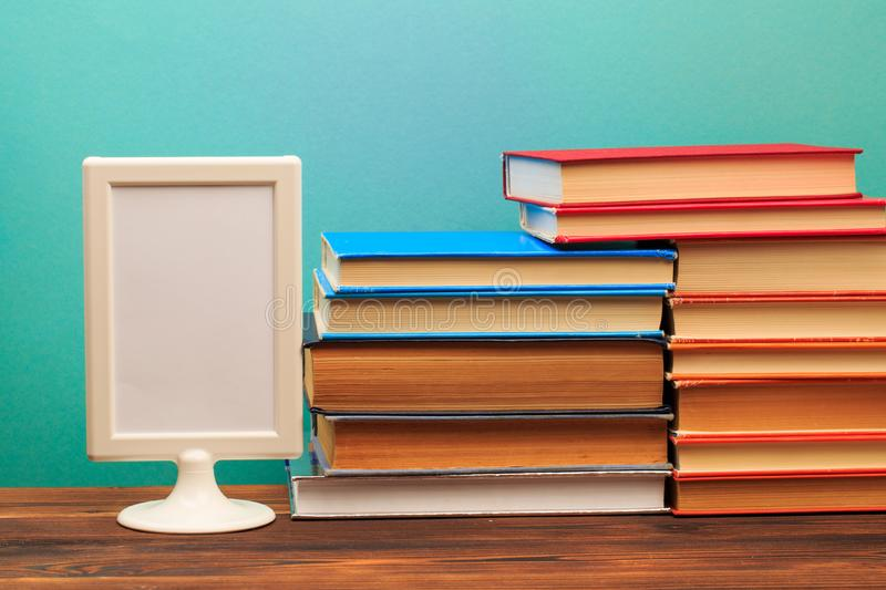 Pile of old books, frame  copy space  on blue background - Image.. royalty free stock photography