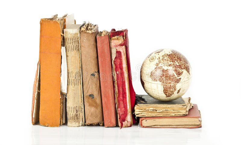 Pile of old books with old globe isolated royalty free stock image