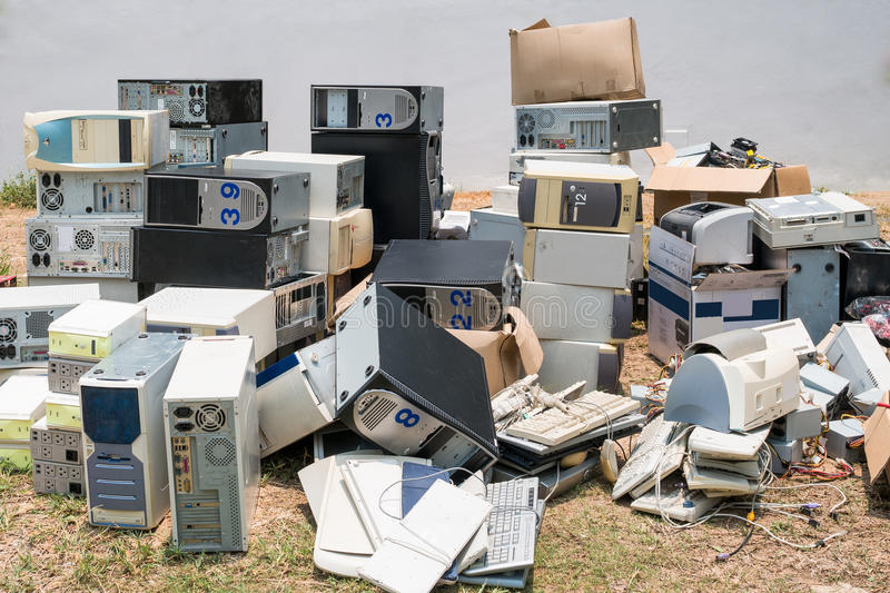 Pile of old computers. A pile of old computers waiting for sending to recycle plant stock photo