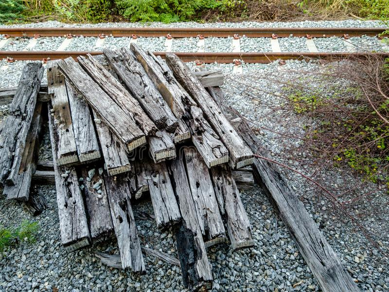 Pile of old and damage railroad sleepers and inactive railway. In the background royalty free stock photos
