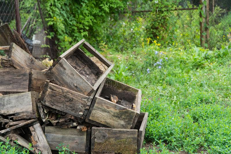 Wooden boxes in the garden. A pile of old empty wooden boxes in the garden stock photography