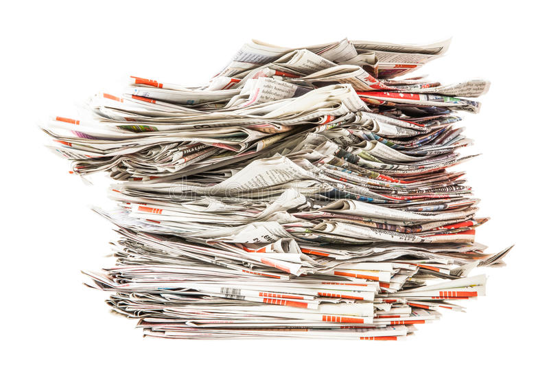 Pile of old folding newspapers. Isolated on white stock photo