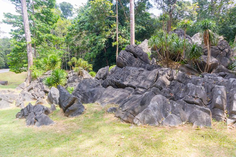 Pile of old and giant rock near the mountain. At thailand royalty free stock photography