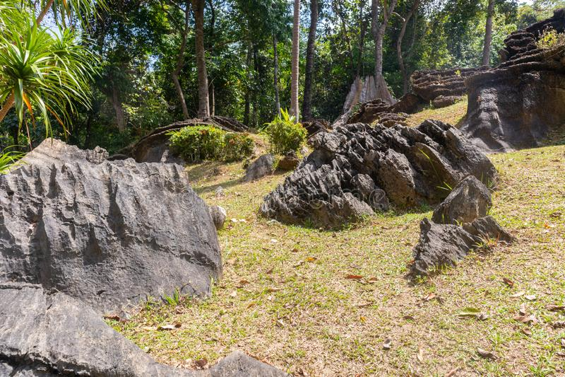 Pile of old and giant rock near the mountain. At thailand stock photos