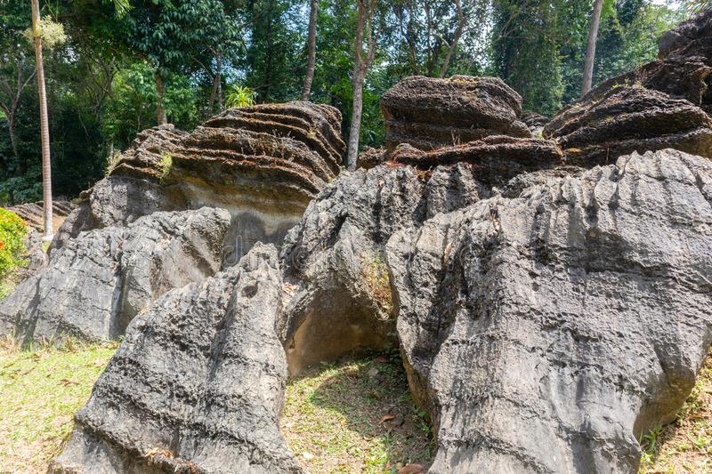 Pile of old and giant rock near the mountain. At thailand stock image