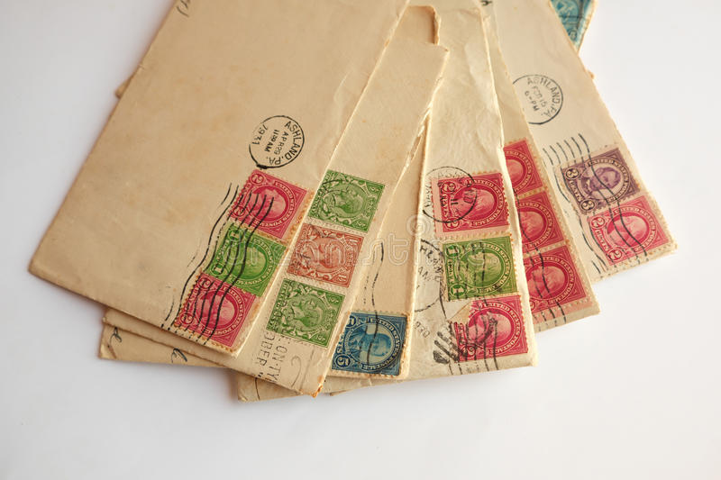 Pile of old letters, envelopes post stamps stock photos