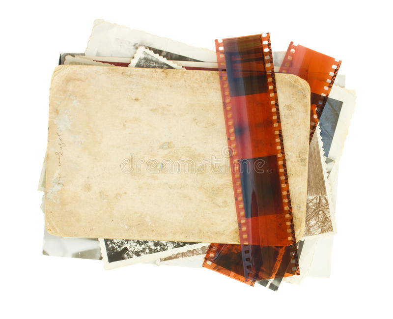 Pile of old photos. With film isolated on white background royalty free stock images