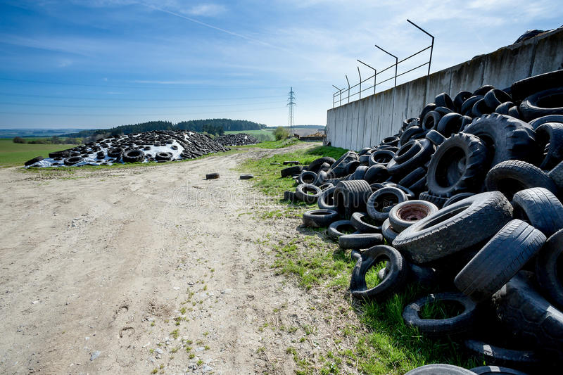 Pile of old tires in farm royalty free stock image