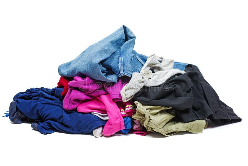 Pile of old, used clothes. Isolated on white stock photos