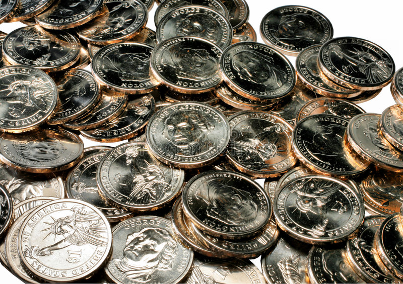 Pile of one dollar coins stock images