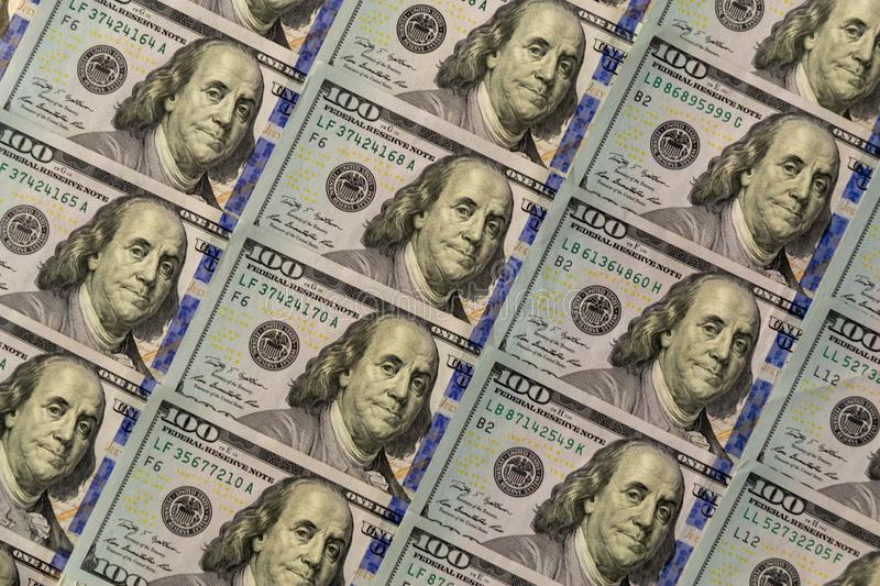 A pile of one hundred US banknotes with president portraits. Cash of hundred dollar bills background royalty free stock photo
