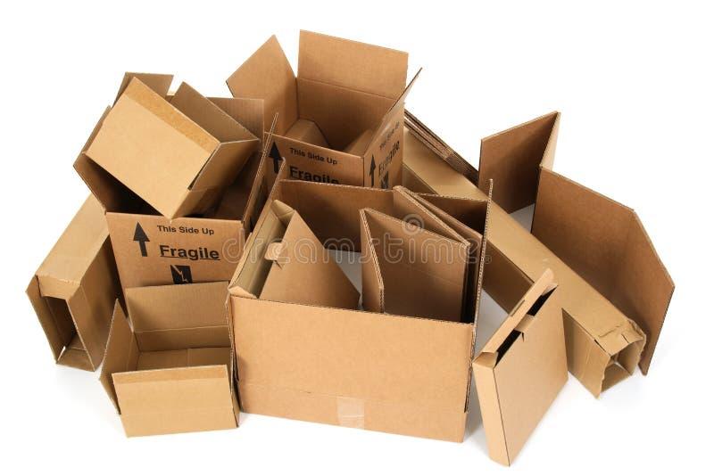 Pile of open cardboard boxes stock photos