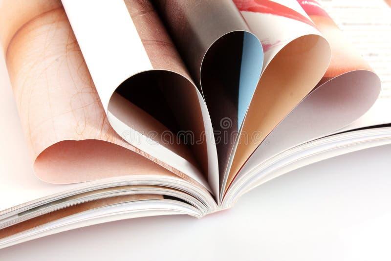 Pile of open magazines i stock image