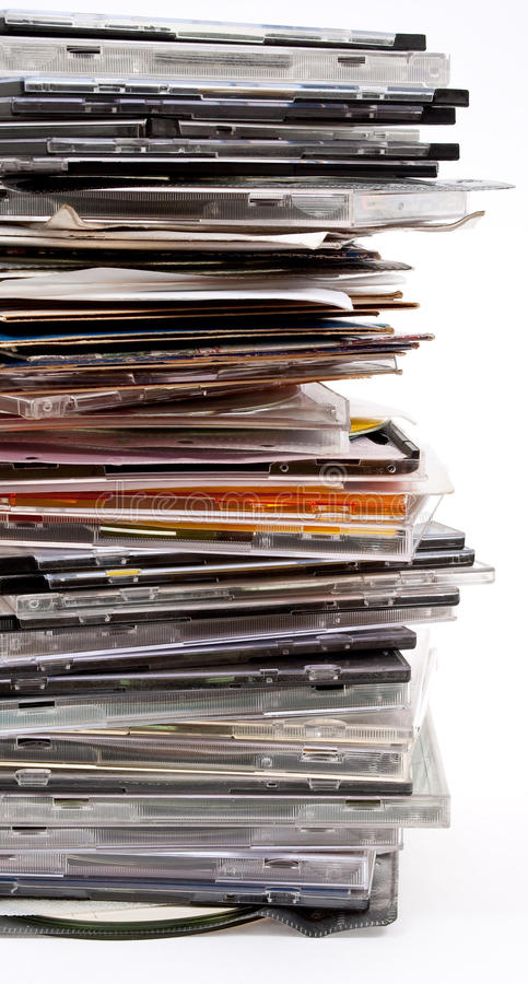 Pile of optical disc cases. On white royalty free stock photography