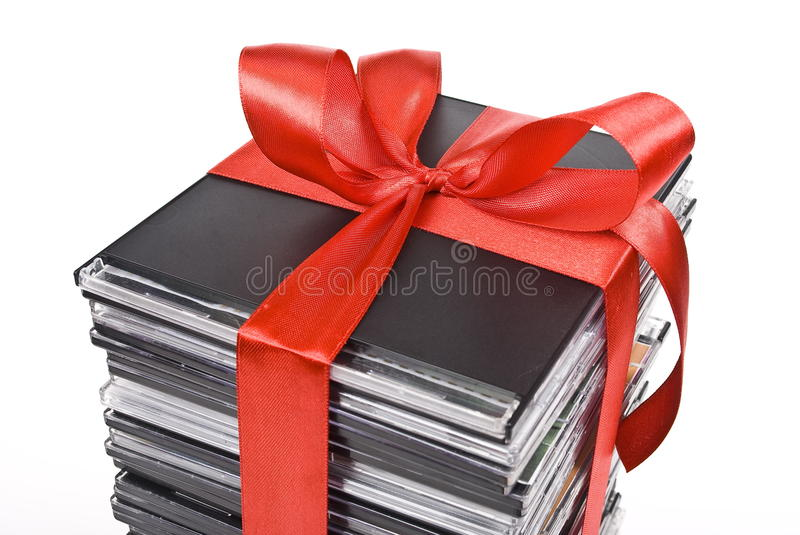 Pile of optical disc with red ribbon. On white stock photography