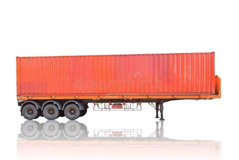 Pile orange de récipient sur le camion de remorque de cargaison photographie stock libre de droits