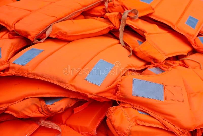 Pile of orange life-jackets. Pile of orange reflective life-jackets stock photography