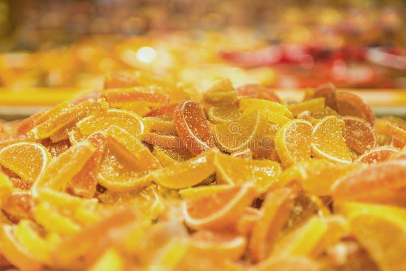 Orange candy marmalade. Pile of orange sweet candy solid marmalade. Background of marmalade stock image