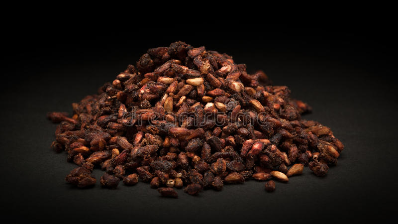 Pile of Organic Dried Pomegranate seeds (Punica granatum). On dark background royalty free stock images