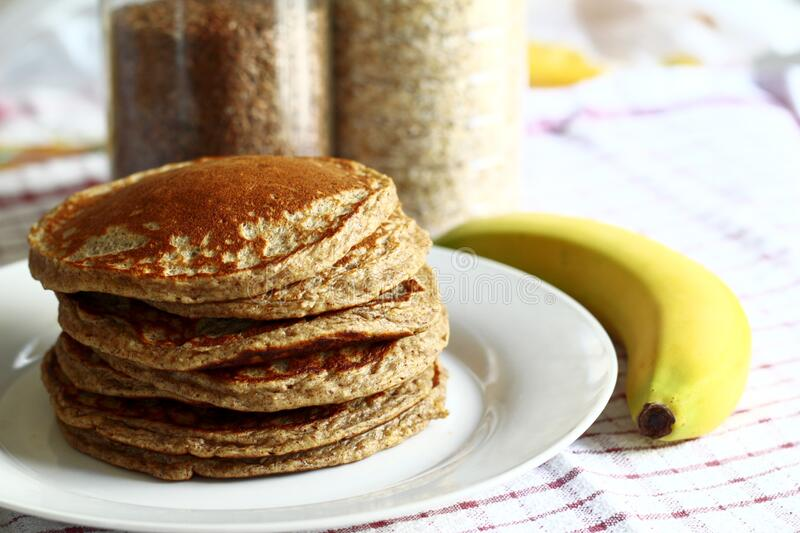 Pile of pancakes with banana stock images
