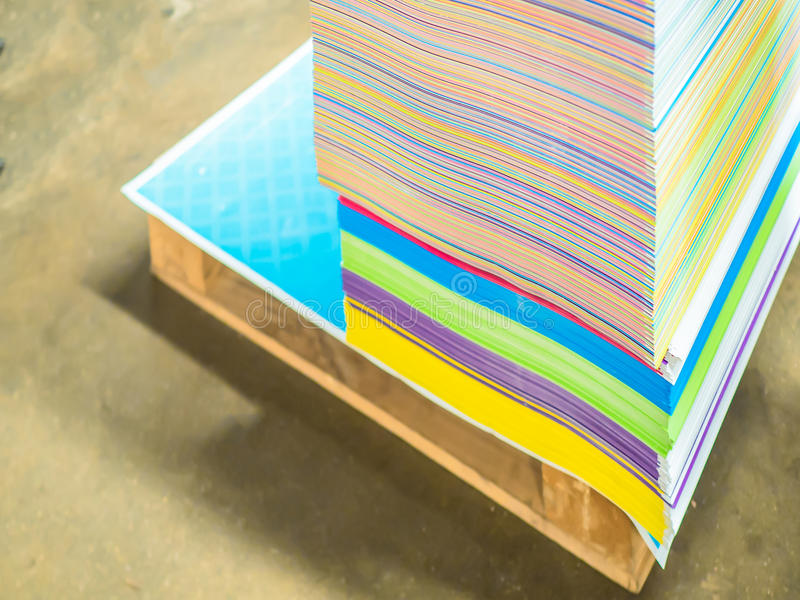 Pile of papers in difference colors ready to make a books. royalty free stock photo