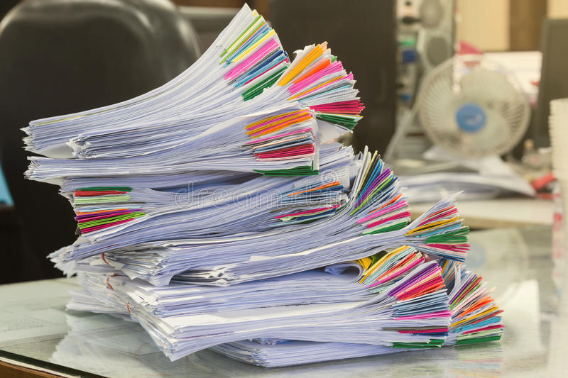 Pile of papers laid overlap on the des royalty free stock photos