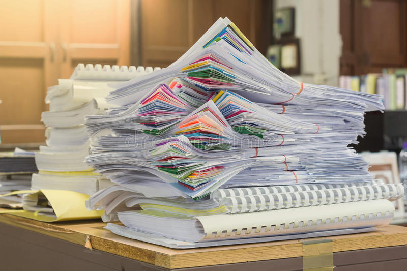 Pile of papers laid overlap on the desk stock images