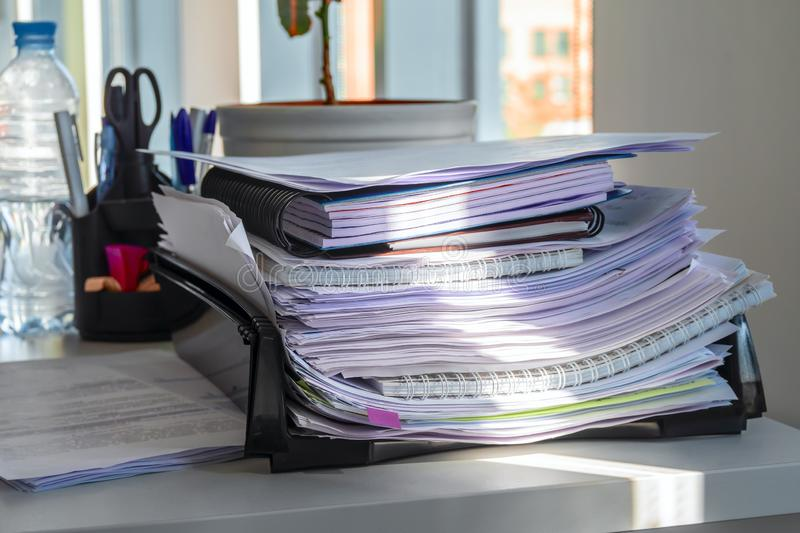 Pile of papers in the office tray. Concept of office clutter and lean production. stock images