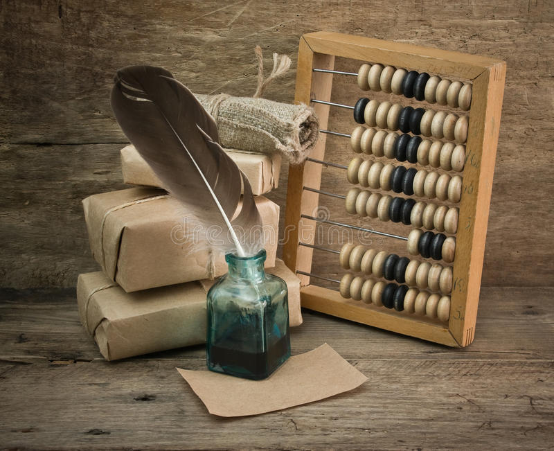 Pile parcel and abacus royalty free stock photo