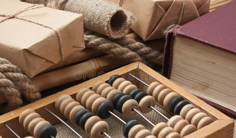 pile parcel and abacus stock photo