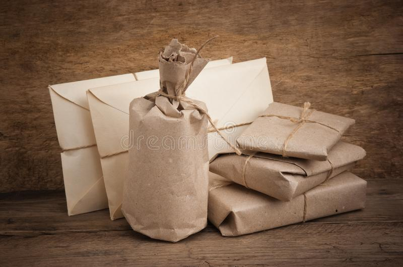 Pile parcel wrapped. With brown kraft paper and tied with twine stock photography