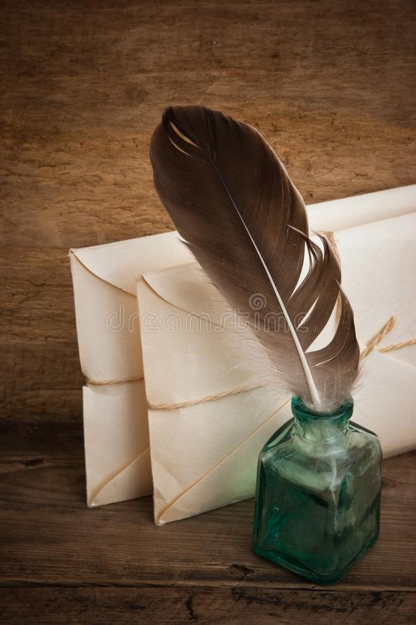 Pile parcel wrapped. Letter and a quill in the inkwell stock photo